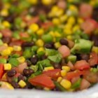Black Bean Salad - This salad is a kaleidoscope of color and taste - black beans, yellow corn, green peppers, and red, red tomatoes. Lime juice, garlic and jalapeno give it some punch.