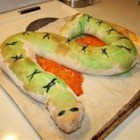 Spooky Calzone Snake - One long calzone, baked in the shape of a snake, can be cut into individual servings after baking. Stuff with your favorite pizza toppings and lots of cheese.