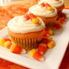 Candy Corn Cupcakes - These pretty and colorful cupcakes are topped with pieces of candy corn to give a hint of the coloring inside!