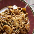 Chicken Lo Mein - A chicken and mushroom stir fry with pungent ginger, sesame and soy overtones, served atop soft noodles.