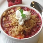 Raspberry Peach Crumble - This is a showstopper, perfect for summer. Serve with vanilla ice cream to make it a perfect dessert.