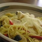 Angel Hair Pasta with Peppers and Chicken - Smoked chicken adds interest to this basic vegetable stir fry, served atop delicate angel hair pasta.