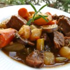 Beef Stew VI - Beef, carrots, potatoes, and celery are seasoned with rosemary and parsley in this simple, stove top beef stew recipe.
