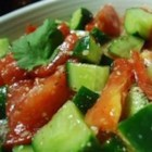 Cucumber and Tomato Salad - A refreshing, light salad for any hot, humid summer day! A great main dish for vegetarians, as well. The basil may be substituted with fresh parsley or mint. Be sure to make this salad just before serving.