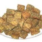 Easy Baked Tempeh - Bite-sized tempeh pieces tossed with a little oil and a lot of flavor from marjoram, coriander, oregano, chives, and brewer's yeast. Baked until golden brown for a delicious snack or side dish. This is a very versatile spice combination that also goes great with potatoes.