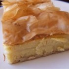 Milk Pie, Galatoboureko - Galataboureko is a sweet Greek treat made with a semolina custard layered into phyllo dough, and soaked with a simple lemon syrup.