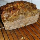 Three-Meat Meatloaf - This moist and delectable meat loaf contains ground turkey, ground beef, and pork sausage for flavor and tenderness.
