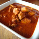 Goan Pork Vindaloo - This traditional Goan pork dish flavored with chilies, garlic and vinegar is spicy and tangy all at the same time. This dish will leave your tastebuds tingling for more.