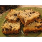 Hello Dollies II - Decadent bar cookies with many layers of goodness. Rich chocolate chips, chewy coconut, pecans baked into the caramelized goodness of sweetened condensed milk.