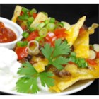 Over the Top Nachos - Ground beef is the key to these hearty classic nachos--it's generously spread over the chips before cheese and toppings.