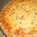 Quiche Supreme - Swiss cheese, Monterey Jack cheese and ham are married with green pepper and onions in a savory custard. This recipe makes 2 quiches.