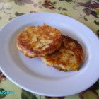 Bacon Cheddar Patty Cakes - Leftover mashed potatoes join forces with Cheddar cheese and crumbled bacon to make a main dish out of yesterday's side dish.