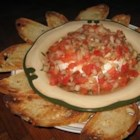 Hot Bruschetta Dip - A small round of brie is softened in the microwave and topped with a flavorful bruschetta mixture. This is excellent for cocktail parties, or any day.