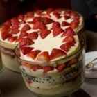 Zuppa Inglese - The luscious colors of this Italian dessert are best displayed in a large glass bowl. Anisette sponge cookies are doused with cherry juice and rum, and layered with vanilla and chocolate pudding, topped with whipped cream and sprinkled with almonds.