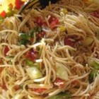 Spaghetti Salad III - Toss a cool summer salad with lots of chopped tomatoes, bell peppers, onion, cucumber, Cheddar cheese and Italian seasoning. Mix in cooked pasta, then blanket with Italian-style salad dressing. Chill thoroughly before serving.