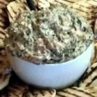 Easy Spinach Dip - Bits of cooked bacon and mozzarella cheese are just two of the ingredients that make this easy spinach dip taste anything but ordinary.