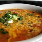 Tex-Mex Turkey Soup - Shredded turkey in a tomato-based soup is jazzed up with herbs and spices for a rich and warming alternative to leftover turkey sandwiches.