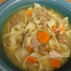 Day-After-Thanksgiving Turkey Carcass Soup - After the big T-day feast, this classic turkey soup makes fine use of a turkey carcass with added vegetables such as carrots, celery, onions, peas, white rice, and even leftover stuffing.
