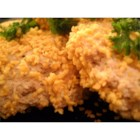 Leftover Turkey Patties - Great way to use leftover turkey! A mixture of chopped turkey meat, flour, crumbs, onion, and cream formed into patties, browned and topped with creamy soup for serving.
