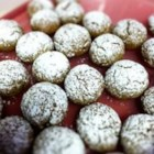 Pfeffernusse Cookies - This recipe for the traditional German Christmas cookie features molasses and honey with a variety of spices.