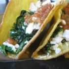 Chard Tacos - Swiss chard is cooked with caramelized onion and served on a warmed corn tortilla with queso fresco and salsa.