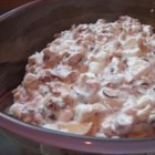Cranberry Salad - This cranberry salad recipe is reminiscent of a Waldorf salad and contains cranberries, apples, marshmallows, nuts, and yogurt.