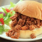 Sloppy Joes II - Ground beef, onion, green pepper, and ketchup are seasoned with garlic powder and sweetened with brown sugar to make this hearty meat filling. Serve on hamburger buns.