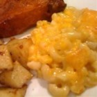 Lucy's Mac and Corn - Creamy corn and processed cheese make a marvelously melted casserole when tossed with macaroni and butter, then baked until golden brown.