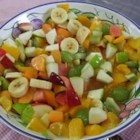 Very Easy Fruit Salad - Who knew that peach pie filling tasted so good when stirred into a bowl of sliced fruit  - kiwi, bananas, grapes, and strawberries? Makes eight very generous servings.