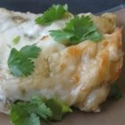 Spinach Enchiladas Verde - Spinach and Monterey Jack cheese are wrapped in corn tortillas and baked with green salsa. You can substitute yogurt for the sour cream if you want a lighter version. This is super simple, and even hard-core Texan meat eaters who have never eaten a vegetable in their lives like it.