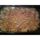 Absolute Best Potato Casserole - Potatoes, ham, and cauliflower are layered, and baked with a delicious Swiss and Cheddar cheese sauce.