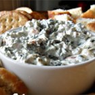 Best Spinach Dip Ever - A flavorful spinach dip with water chestnuts fills a tasty bread bowl. The perfect recipe for entertaining.
