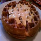 Cornmeal Bacon Waffles with Cheese Sauce - Great for brunch. A nice alternative to sweet waffles, these cornmeal waffles are ironed with a slice of bacon, and served with a creamy cheese sauce.