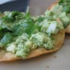 Avocado Tacos - Lightly seasoned avocados and diced onions are spread on toasted tortillas and served with cilantro and jalapeno sauce.