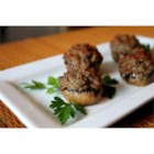 Stuffed Mushrooms IV - A savory meat and bread mixture seasoned with chili powder is baked into a buttered button mushroom cap in this appetizer which is served hot.
