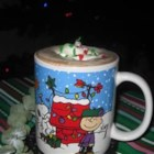 Cocoa Sleigh Ride - A festive cup of cocoa that will bring out the kid in everyone!  Top instant cocoa with whipped cream, red and green sprinkles and a cherry.  Use more or less toppings, as desired.