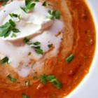 Roasted Red Pepper and Crab Soup - Flakes of crabmeat are accented with cayenne, basil and garlic in this creamy, roasted pepper bisque.