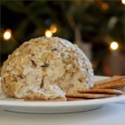 Traditional Christmas Cheese Ball - Cream cheese is blended with sweet onion, smoked beef, Worcestershire sauce, and chopped green olives, then wrapped in chopped walnuts. Serve with crisp Ritz crackers to complement the savory taste and creamy texture.