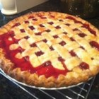 Sour Cherry Pie - This is a sour cherry pie recipe that is SO simple I can put it together and get in the oven in less than 10 minutes.  The hardest thing about this pie is tracking down canned sour cherries but if you look carefully, you can find them in most grocery stores. When the pie is served, top with vanilla ice cream to add the element of sweet to the sour!