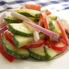 Refreshing Cucumber Salad - This is a quick and easy throw-together salad that is super tangy and creamy and a way to use up some of your fresh garden veggies.  Very refreshing! Increase or decrease amount of vinegar and mayonnaise to your liking.
