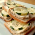 Cucumber Sandwiches I - Slices of cocktail rye bread are spread with a cream cheese mixture and topped with cucumber.