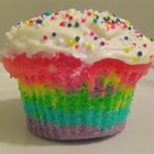 "Rainbow Clown Cake - Gel or paste food colorings are the secret to the ""tie-dyed"" effect in this colorful cake mix cake."