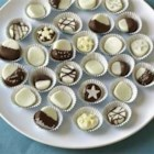 Peppermint Creams - Confectioners' sugar, egg white and peppermint extract kneaded into shapes and allowed to set up overnight.