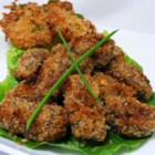 Venison Tenderloin Bites - Breaded and broiled venison tenderloin is served on a bed of peppery arugula with a drizzle of lemon juice.
