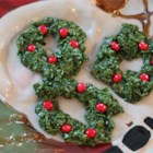 Christmas Cornflake Wreath Cookies - These cookies look like little Christmas Wreaths and are great fun for the kids to help with.  Very Easy.  People always look at these suspiciously, but once they try them, they can't get enough.  Recipe may be halved.
