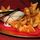 Crab Rangoon III - Wonton wrappers filled with a creamy crabmeat mixture are deep fried until golden brown. They make wonderful appetizers!