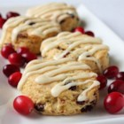 Cranberry Eggnog Cornbread Scones - Add a splash of holiday spirit to breakfast scones by stirring dried cranberries and eggnog into a classic baking combination of flour, sugar, cornmeal, salt, butter, and baking powder.
