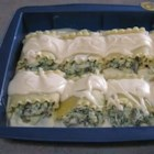 Lasagna Alfredo Roll Ups - Impress dinner guests with these picture-perfect portions of lasagna. Roll up cooked noodles with a spinach/ricotta filling and bake with a blanket of creamy rich Alfredo sauce.