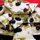 Cherry-Pistachio Bark - Vanilla-scented white chocolate bark with dried cherries and pistachios. So simple to prepare in the microwave, then just wait for it to set for a delicious holiday treat.