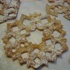 Scandinavian Snowflake Cookies - Dough is rolled into paper-thin circles, folded, and cut out like paper snowflakes to make beautiful lacy flat breads that are fried and sprinkled with confectioners' sugar. A traditional Christmas treat from Scandinavia. They take time and care to make.
